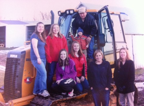 Dale and his family on his D3K Bulldozer