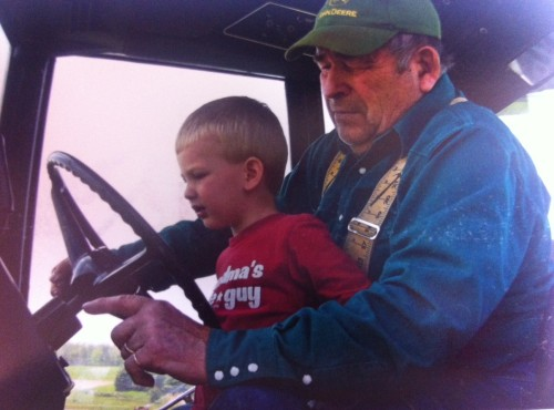 Dale and his great-grandson, Austin, in his Case IH 1086.